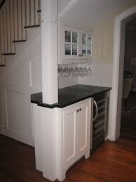 interior mini bar under stairs for maximizing limited space in