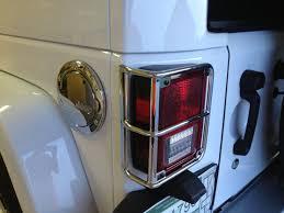 gas cap light jeep chrome mopar gas cap and tail light guards for a 2013 jeep wrangler