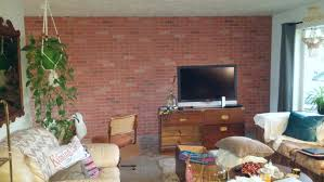 in the livingroom living room makeover faux brick wall paneling vintage cottage
