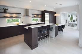 kitchen essentials jeffrey harrington homes one of the advantages to an island is a great staging area that allows you to effectively work close to your kitchen