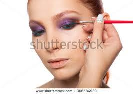 doing hair and makeup professional makeup artist doing stock photo 366584939