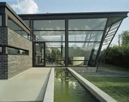 stylish modern house design idea with gray stone wall door