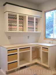 kitchen cabinet interior dress up your cabinets with these easy diy fabric inserts all