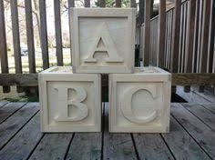 white and cream baby block centerpiece for babyshower abc blocks