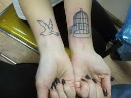 27 dazzling bird cage wrist tattoos