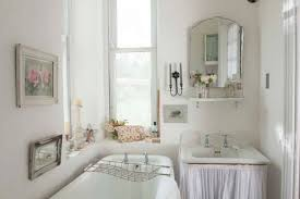 small shabby chic bathroom with vintage accessories and clawfoot