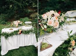 wedding flowers calgary guestbook signing table with floral garland and garden style