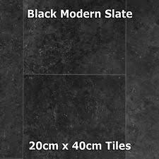 b q harmonia black slate tile effect laminate flooring 8mm 2 05m