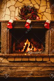 warm cozy fireplace decorated for christmas with real wood burning