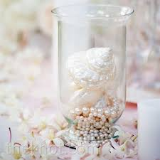 Seashell Centerpiece Ideas by Beach Wedding Centerpiece Idea Using Shells And Pearls Beach