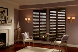 interior brown graber shutters with wall sconces also shag area