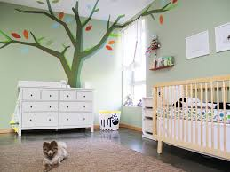 interior modern green color baby nursery featuring cream wooden