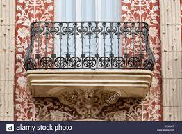 exterior detail view of wrought iron balcony and modernist stock