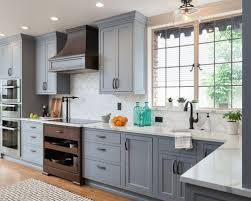 blue gray for kitchen cabinets beautiful blue cabinets bring warmth and character to these