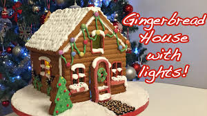 decorated gingerbread house with lights cheeky crumbs youtube