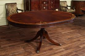Oval Dining Table With Leaves High End Mahogany Dining Table In A Walnut Finish 48 To 66