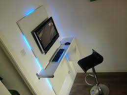 minimalist bedroom with sleek workstation built wall mounted