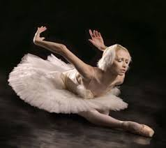 A dancer portraying a swan from swan lake