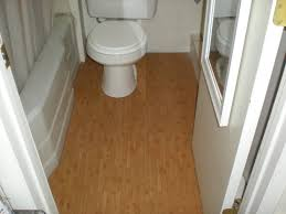 Difference Between Vinyl And Laminate Flooring Excellent White Half Bathroom Design With White Toilet On Wooden