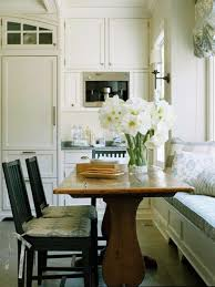 appealing small kitchen with wooden dining table balck hiars and