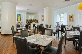 dining at tempt the saint hotel new orleans