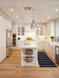 coastal cottage kitchen marble counters wood floors stainless