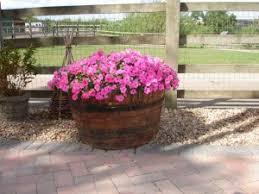 wooden barrel planters homebase garden design ideas