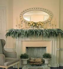 decorating a fireplace mantle with leaves and floer vases and