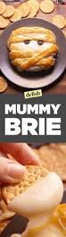 halloween themed appetizers adults how to make mummy brie video delish com