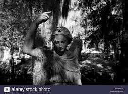 usa georgia savannah graveyard statue and trees draped in