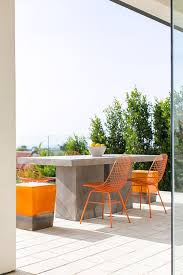 Metal Outdoor Dining Chairs Concrete Block Outdoor Dining Table With Orange Metal Dining