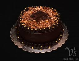 dark chocolate cake filled with nutella mousse and frosted with