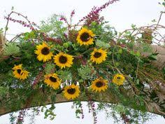 Wedding Arches Decorated With Burlap Decorated Wedding Arch With Burlap And Sunflowers Perfect For A