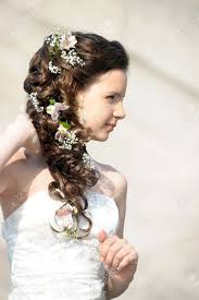 bridal hairstyle images with a wedding hairstyle with flowers stock photo picture