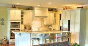 how do you clean yellowed white kitchen cabinets how to fix a dented refrigerator door hunker unfinished