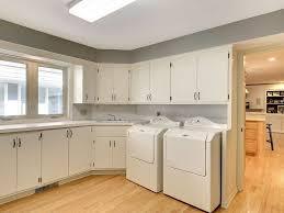 traditional laundry room with built in bookshelf u0026 hardwood floors