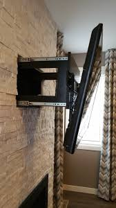 this is a fireplace with built in hidden drawer behind tv mount to
