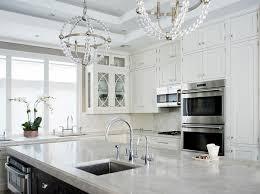 espresso kitchen island with white quartzite countertops