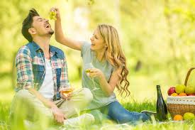 Lessons You Should Learn From Online Dating and a Bad First     Young beautiful couple dressed casual having picnic in park eating grape and drinking wine