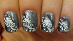 magnetic grey and white swirly design on short nails with icy blue