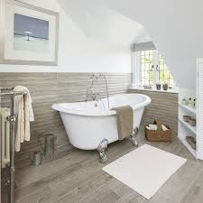 scandi inspired bathroom with roll top bath and wood effect tiles