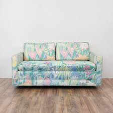 this tropical 80 u0027s style loveseat is upholstered in a vibrant neon