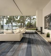 large modern living room lake house design with gray wide plank
