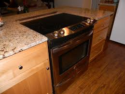 recycled countertops kitchen island with stove and oven lighting
