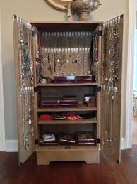 cheap media cabinet and 90 command hooks turned jewelry storage
