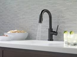 modern kitchen faucet modern kitchen with white countertops and black faucet an