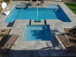 custom backyard swimming pool spa with sun deck and built in table
