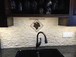 small kitchen back splash medallions mosaic stone and metal