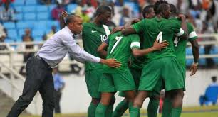 Image result for images of the super eagles and swaziland national team playing in the pitch