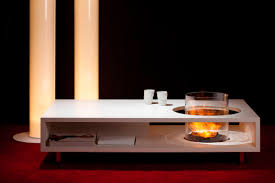 impressive indoor coffee table fireplace design with glass